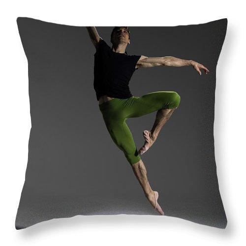 Ballet Dancer Throw Pillow featuring the photograph Male Ballet Dancer Jumping In Passé by Nisian Hughes
