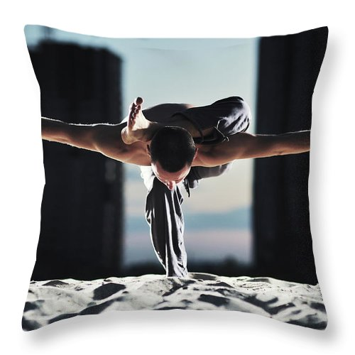 People Throw Pillow featuring the photograph Man Holding Yoga Pose In The Sand by Myshkovsky