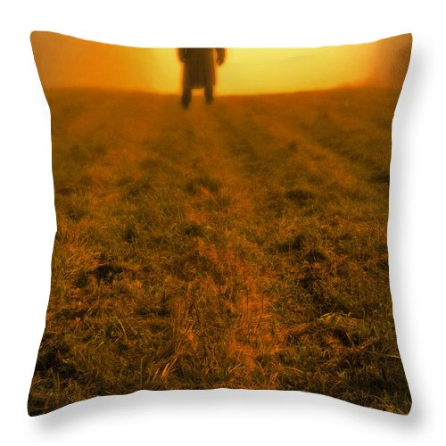Man Throw Pillow featuring the photograph Man In Field At Sunset by Edward Fielding