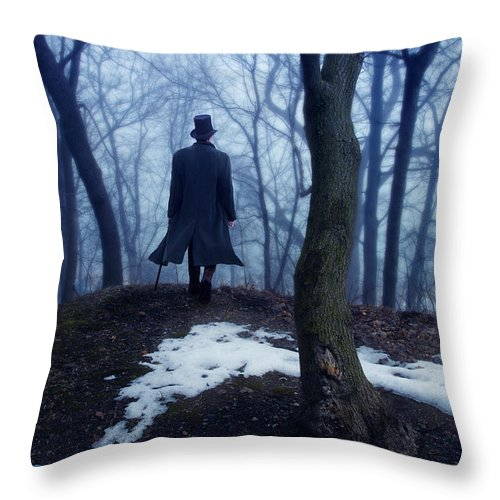 Young Throw Pillow featuring the photograph Man In Top Hat Walking Through Foggy Woods by Jill Battaglia