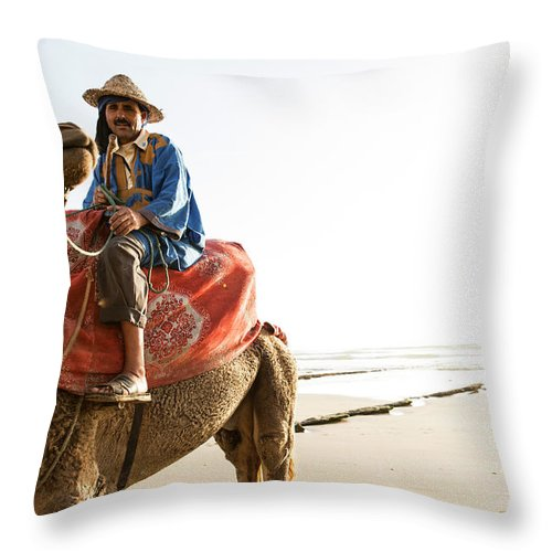 Agadir Throw Pillow featuring the photograph Man On Camel On Beach, Taghazout by Tim E White