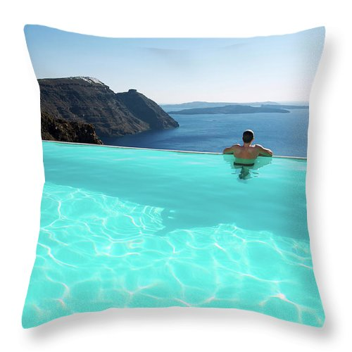 People Throw Pillow featuring the photograph Man Relaxing Looking At Santorini by Peskymonkey