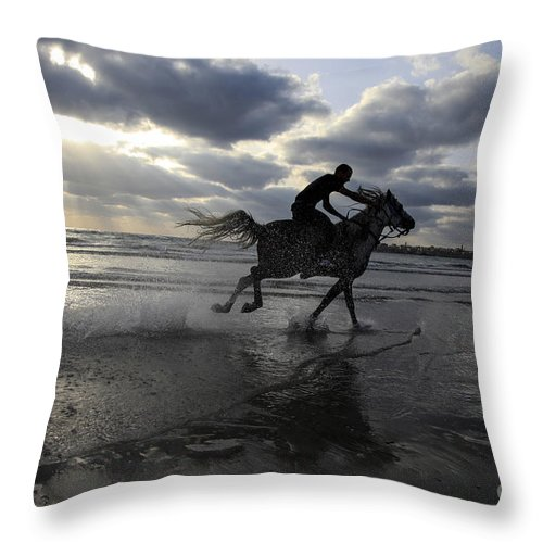 Silhouettes Throw Pillow featuring the photograph Man Rides A Horse by Vladi Alon