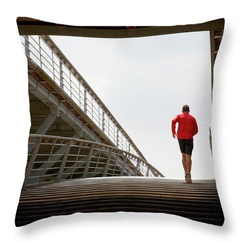 Steps Throw Pillow featuring the photograph Man Running Up A Bridge by Chris Tobin