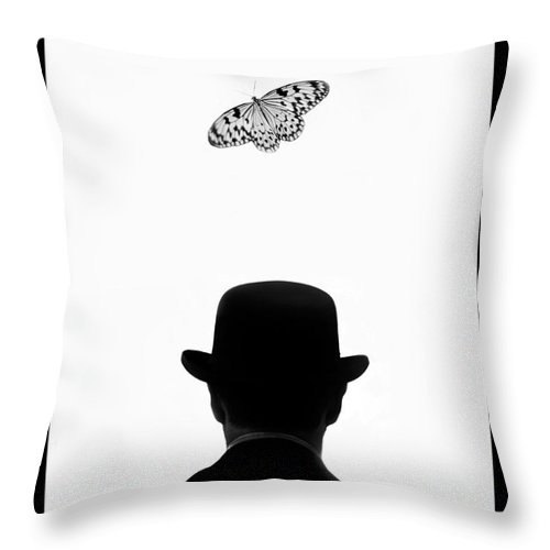 Mature Adult Throw Pillow featuring the photograph Man Standing Under Butterfly by Grant Faint