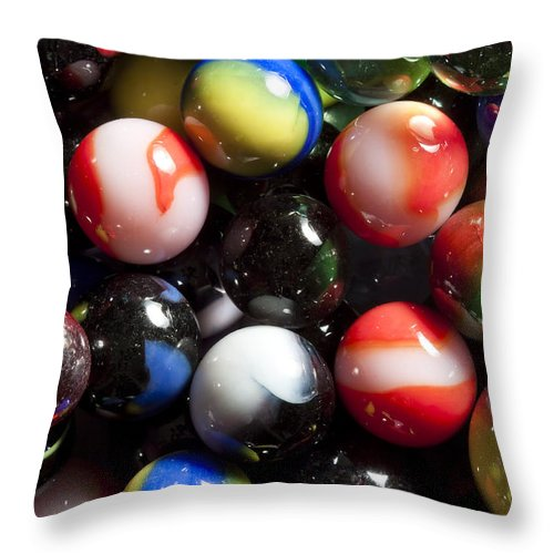 Glass Throw Pillow featuring the photograph Marble King Marbles 1 by John Brueske