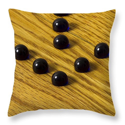 Glass Throw Pillow featuring the photograph Marbles Arrow Blue 1 by John Brueske