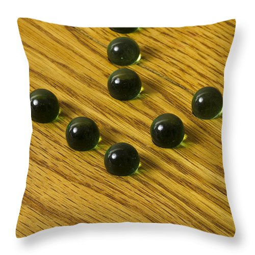 Glass Throw Pillow featuring the photograph Marbles Arrow Green 1 by John Brueske