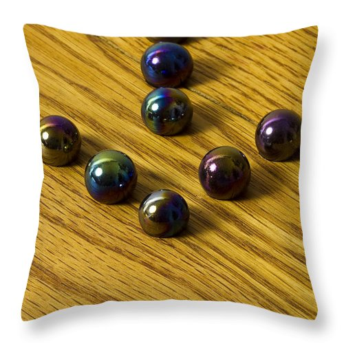 Glass Throw Pillow featuring the photograph Marbles Arrow Oilys 1 by John Brueske