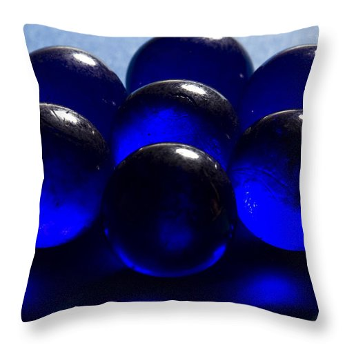 Glass Throw Pillow featuring the photograph Marbles Blue 1 C by John Brueske