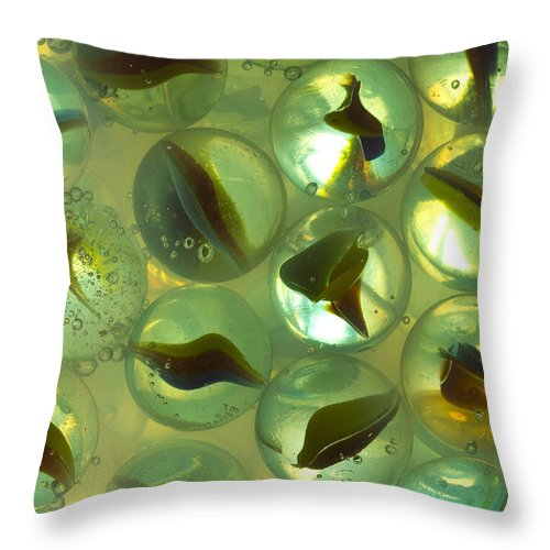 Glass Throw Pillow featuring the photograph Marbles Cat Eyes Soda 1 B by John Brueske