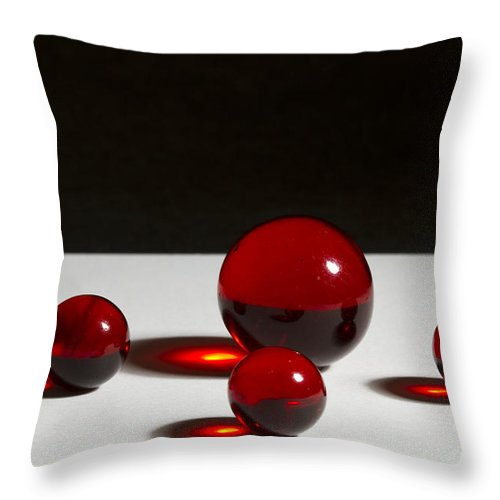 Glass Throw Pillow featuring the photograph Marbles Red 1 B by John Brueske