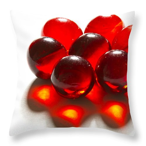 Glass Throw Pillow featuring the photograph Marbles Red 3 C by John Brueske