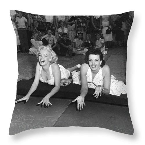 1950's Throw Pillow featuring the photograph Marilyn Monroe And Jane Russell by Underwood Archives