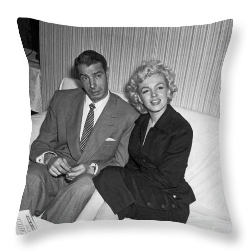 1954 Throw Pillow featuring the photograph Marilyn Monroe And Joe Dimaggio by Underwood Archives