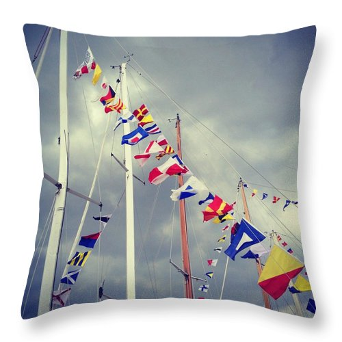 Pole Throw Pillow featuring the photograph Marine Signal Flags On Mast Against A by Jodie Griggs