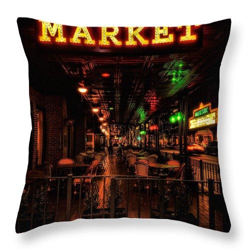 Market On Houston Street Throw Pillow featuring the photograph Market On Houston by Wayne Kondoff