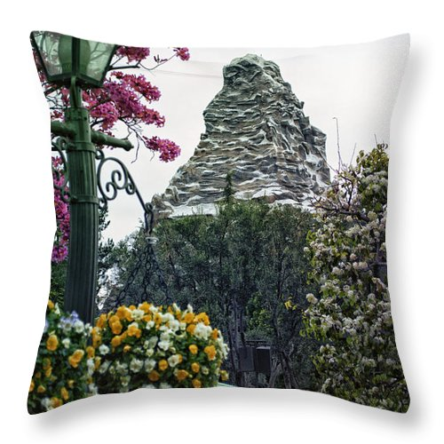 Disney Throw Pillow featuring the photograph Matterhorn Mountain With Flowers At Disneyland by Thomas Woolworth