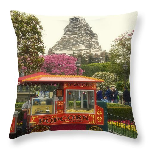 Disney Throw Pillow featuring the photograph Matterhorn Mountain With Hot Popcorn At Disneyland 01 by Thomas Woolworth