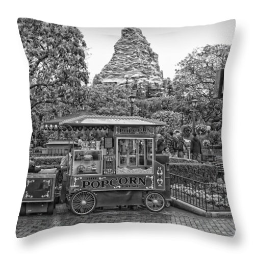 Disney Throw Pillow featuring the photograph Matterhorn Mountain With Hot Popcorn At Disneyland Bw by Thomas Woolworth