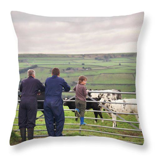 Mature Adult Throw Pillow featuring the photograph Mature Farmer, Adult Son And Grandson by Monty Rakusen