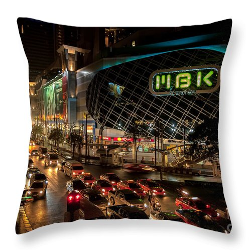 Cityscape Throw Pillow featuring the photograph Mbk Bangkok by Adrian Evans