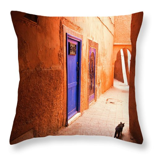 Arch Throw Pillow featuring the photograph Medina Of Marrakesh by Moreiso
