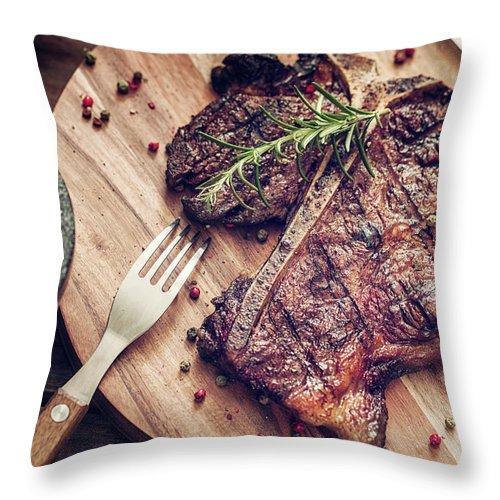 Rosemary Throw Pillow featuring the photograph Medium Roasted T-bone Steak by Gmvozd