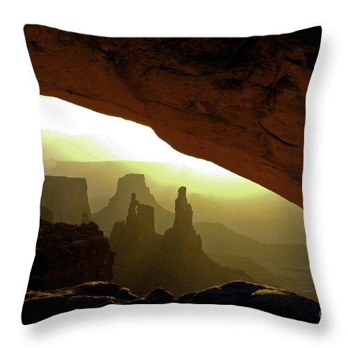 Mesa Arch Canyonlands National Park Utah Arches Sunrise Sunrises Red Rock Formation Formations Parks Reflected Light Early Morning Dawn Landscape Landscapes Landmark Landmarks Throw Pillow featuring the photograph Mesa Arch At Sunrise by Bob Phillips