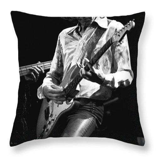 Mick Ralphs Throw Pillow featuring the photograph Mick In Flight 1977 by Ben Upham