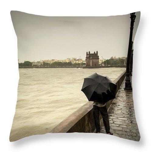 People Throw Pillow featuring the photograph Monsoon In Mumbai by Frank Bunnik