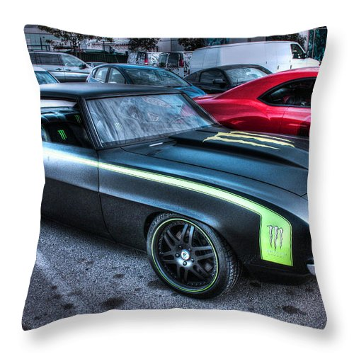 1969 Chevy Camaro Throw Pillow featuring the photograph Monster Camaro by Tommy Anderson