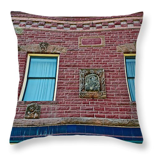 Moore Block-1896 With Gargoyle-like Features In Pipestone Throw Pillow featuring the photograph Moore Block-1896 With Gargoyle-like Features In Pipestone-minnesota by Ruth Hager