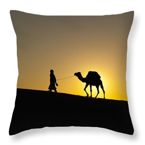 Direction Throw Pillow featuring the photograph Morocco, Silhouette Of Berber Blue Man by Ian Cumming