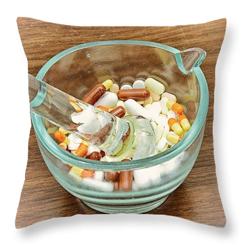 Medicine Throw Pillow featuring the photograph Mortar And Pestle With Drugs by Paulo Goncalves