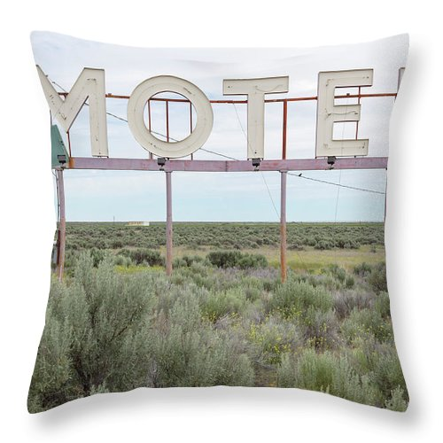 Grass Throw Pillow featuring the photograph Motel Sign In Field Of Sage Brush, Out by Mint Images