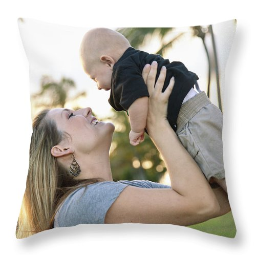 Ala Moana Throw Pillow featuring the photograph Mother And Baby by Brandon Tabiolo