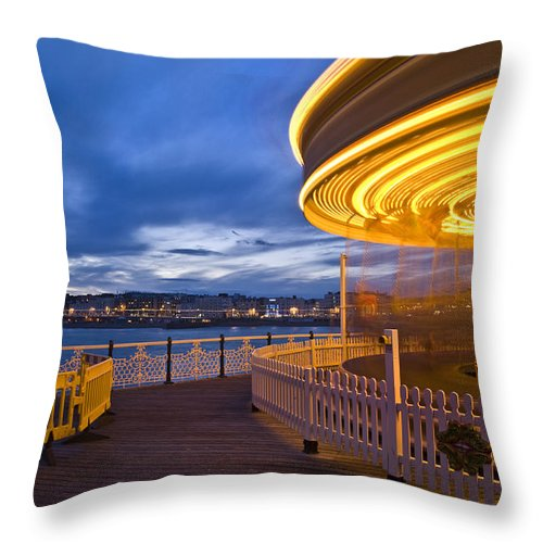 Carousel Throw Pillow featuring the photograph Moving Carousel by Matthew Gibson