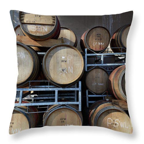 Stellenbosch Throw Pillow featuring the photograph Multible Wooden French Winebarrels On by Klaus Vedfelt