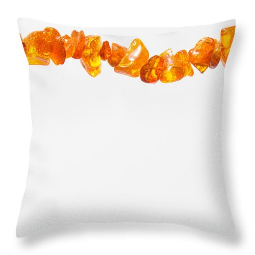 Abstract Throw Pillow featuring the photograph Natural Amber Necklace by Alain De Maximy