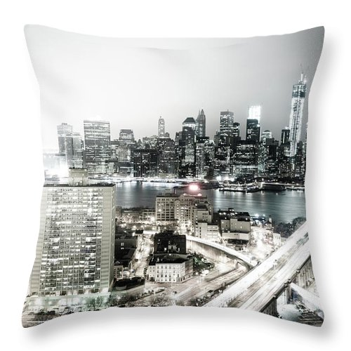 Lower Manhattan Throw Pillow featuring the photograph New York City Skyline At Night by Mundusimages