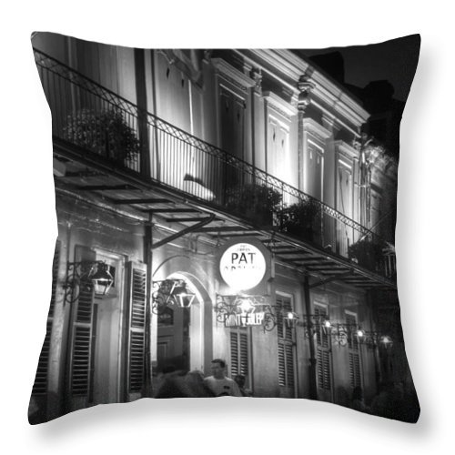 Pat O'brien's Throw Pillow featuring the photograph Night At Pat O'brien's by Greg and Chrystal Mimbs