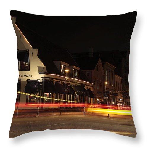 Night Scene Throw Pillow featuring the photograph Night Scene At The Intersection Of Main Street And Schutstraat In Hoogeveen by Ronald Jansen