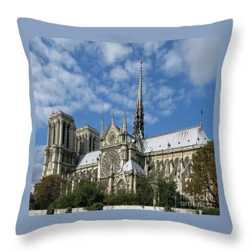 Notre Dame Throw Pillow featuring the photograph Notre Dame Cathedral by Ann Horn