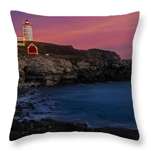 Nubble Lighthouse Throw Pillow featuring the photograph Nubble Lighthouse At Sunset by Susan Candelario