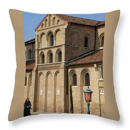 Throw Pillow featuring the photograph Nun Walking by Ron Harpham