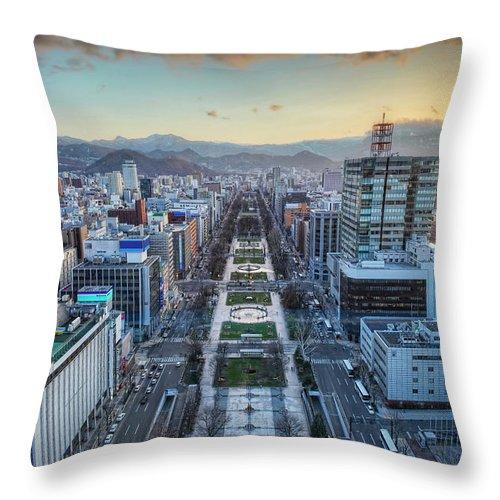 Hokkaido Throw Pillow featuring the photograph Odori Park Sunset by Daniel Chui