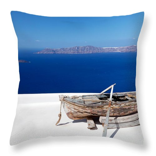 Santorini Throw Pillow featuring the photograph Old Boat On The Roof Of The Building On Santorini Greece by Michal Bednarek