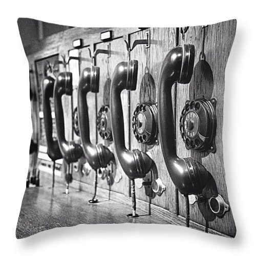In A Row Throw Pillow featuring the photograph Old-fashioned Wooden Telephone by Anja Heid / Eyeem