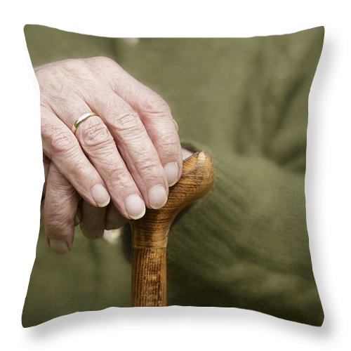 Walking Stick Throw Pillow featuring the photograph Old Hands Of A Senior On Walking Stick by Juergen Ritterbach